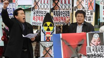 SEOUL, SOUTH KOREA - FEBRUARY 12: South Korean conservative protesters participate in the anti-North Korea rally demonstrating against North Korea's nuclear test on February 12, 2013 in Seoul, South Korea. North Korea confirmed it had successfully carried out an underground nuclear test, as a shallow earthquake with a magnitude of 4.9 was detected by several international monitoring agencies. South Korea and Japan both assembled an emergency meeting of their respective national security teams after the incident. (Photo by Chung Sung-Jun/Getty Images)