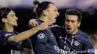 Paris Saint-Germain's Ezequiel Lavezzi, from Argentina, right, celebrates with teammate Zlatan Ibrahimovic from Sweden, center, after he scored against Valencia during a Champions League round of 16 first leg soccer match at the Mestalla stadium in Valencia, Spain, Tuesday, Feb. 12, 2013. (Photo: AP Photo/ Fernando Hernandez)