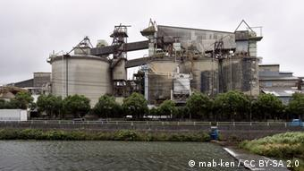 A view of a cement factory facility, with a river running by in the foreground (mab-ken / CC BY-SA 2.0) http://www.flickr.com/photos/kentamabuchi/5950328538/ ++ mab-ken / CC BY-SA 2.0 ++