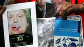Demonstrators in the Netherlands show images of slain filmmaker Theo van Gogh