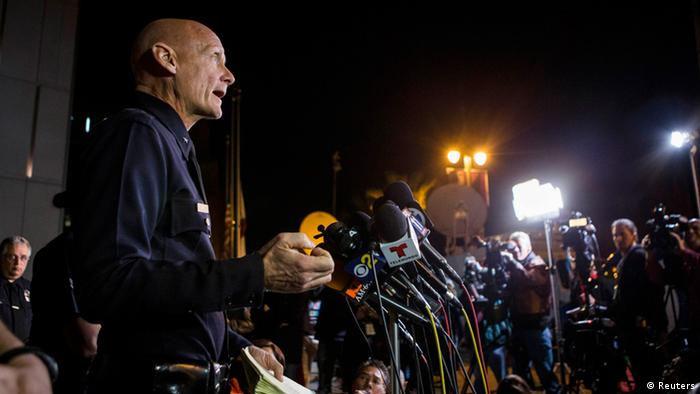 Los Angeles Police Commander Andrew Smith speaks during a news conference to update the public on the manhunt for former Los Angeles police officer Christopher Dorner, at the Los Angeles Police Department in Los Angeles, California February 12, 2013. A gunman thought to be the ex-cop who led California authorities on a six-day manhunt barricaded himself inside a mountain cabin northeast of Los Angeles on Tuesday and traded gunfire with lawmen, killing one before the cabin burned to the ground. Hours after the cabin went up in flames, Los Angeles police said no body had yet been recovered from the smoldering ruins, despite several media reports to the contrary, because the site was still too hot for police to enter and search. REUTERS/Bret Hartman (UNITED STATES - Tags: CRIME LAW)