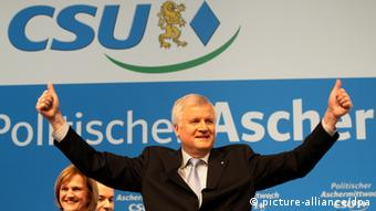 Bavaria's premier Horst Seehofer gesticulating with outstretched arms at the CSU rally in Passau on Ash Wednesday. Photo: Stephan Jansen/dpa