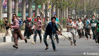 Bangladesh Jammat-e-Islami activists throw bricks as they clash with police in Dhaka February 12, 2013 (Photo: REUTERS/Andrew Biraj)