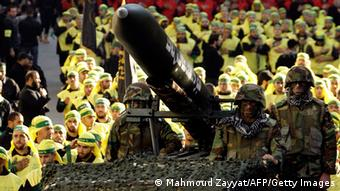 Hezbollah militants ride on a vehicle carrying a Fajr 5 missile MAHMOUD ZAYYAT/AFP/Getty Images)