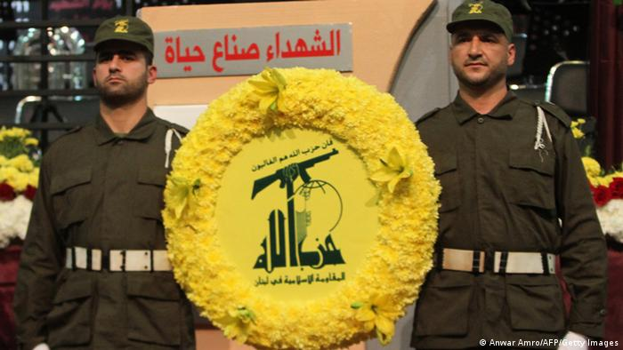 Members of militant Shiite Muslim group Hezbollah carry a wreath on the occasion of the party's Martyrs' Day in southern Beirut, on November 12, 2012. AFP PHOTO / ANWAR AMRO (Photo credit should read ANWAR AMRO/AFP/Getty Images)