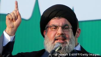 Lebanon's Hezbollah chief Hassan Nasrallah addresses thousands of supporters who took to the streets of southern Beirut to denounce a film mocking Islam on September 17, 2012. AFP PHOTO / JOSEPH EID (Photo credit should read JOSEPH EID/AFP/GettyImages)