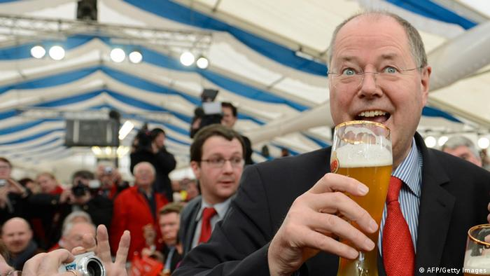 German Social Democratic Party (SPD) chancellor candidate Peer Steinbrueck salutes with beer ahead the SPD Ash Wednesday event in Vilshofen, southern Germany, on February 13, 2013. Photo: CHRISTOF STACHE/AFP/Getty Images 161614020