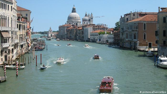 Boat traffic on the Venice canals. (AP Photo/Raf Caser)