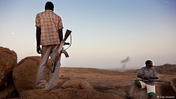 Two men in South Kordofan holding automatic weapons Photo: Cap Anamur