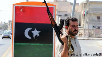 A Libyan Rebel looks on at a checkpoint, in Souk Al Joumoua in Tripoli, Libya, 30 August 2011. in Tripoli, Libya, 30 August 2011. According to media report on 30 August, Libyan areas loyal to the fugitive leader Muammar Gaddafi have until the 03 of September to surrender,'We cannot wait more than this' chief of the opposition Transitional National Council Mustafa Abdel Jalil said, he hoped that the rebels would enter Sirte and southern areas peacefully to 'avoid more bloodshed and destruction'. EPA/MOHAMED MESSARA