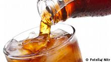 Cola is pouring into glass on white background Bild: #41087966