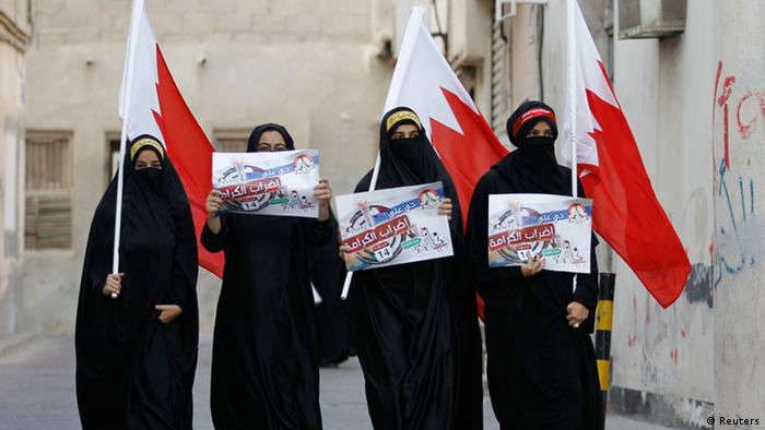 Anti-government protesters hold Bahraini flags and signs saying We will return till Judgment Day, as they participate in a protest in the village of Sanabis, west of Manama, February 11, 2013. REUTERS/Hamad I Mohammed (BAHRAIN - Tags: POLITICS CIVIL UNREST)