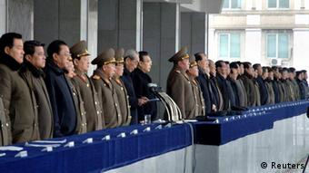 North Korean officials standing to attention(Reuters)