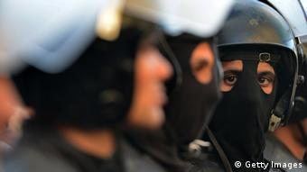 Egyptian riot policemen stand guard during a demonstration outside the high court in central Cairo on January 30, 2013. Egyptian authorities detained suspected Black Bloc members as they protested an order by the public prosecutor to arrest anyone from the shadowy opposition group, an AFP journalist said. Presenting themselves as the defenders of protesters opposed to President Mohamed Morsi's rule, the Black Bloc reportedly models itself on anarchist groups of the same name in Europe and the United States. AFP PHOTO / KHALED DESOUKI (Photo credit should read KHALED DESOUKI/AFP/Getty Images)