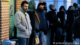 Unemployed people line up at a job center in Alcala de Henares, near Madrid, Spain on 10 February 2010. The number of unemployed workers in Spain increased in January 2010 by 124,890 people from December 2009, according to the Government's Survey of the Working Population (EPA in Spanish). This is the sixth consecutive rise of the level of unemployment in Spain. The EPA shows that Spain reached its highest level of unemployment ever in December 2009, when 4,326,000 people (18.83 per cent of the working population) were unemployed. EPA/FERNANDO VILLAR