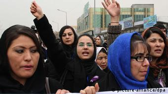 Afghan women shout slogans during a protest against the rising incidents of violence against women in Kabul, Afghanistan, 14 February 2013. (Photo: EPA)