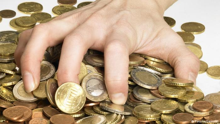 Hand grabbing coins