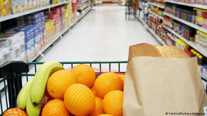 Grocery cart loaded with fresh fruit and bread moving through the aisle. #2583402 Barbara Helgason - Fotolia.com 2007