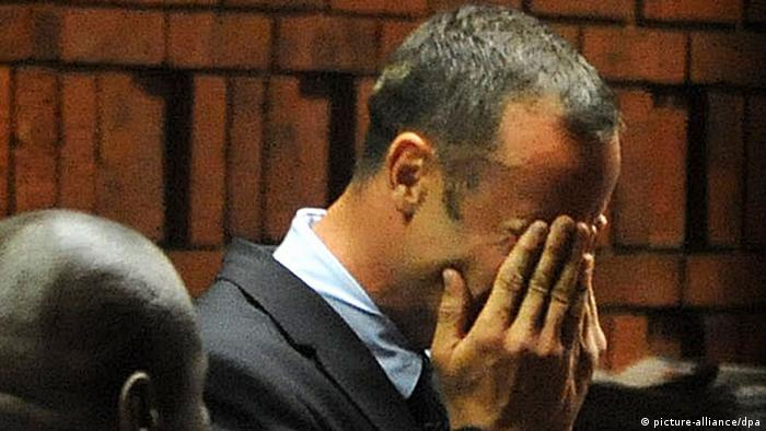 epa03585062 South African paralympic and Olympic sprinter, Oscar Pistorius (C) weeps as he appears in the Pretoria magistrates court after spending the night in police custody in Pretoria, South Africa 15 February 2013. Pistorius has been officially charged with murder. He was arrested 14 February 2013 for allegedly shooting and killing his girlfriend Reeva Steenkamp at his home in the Silverwoods security estate in Pretoria, South Africa. EPA/Antoine de Ras SOUTH AFRICA OUT