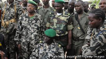 Mali junta leader Captain Amadou Sanogo poses surrounded by his fellow soldiers in Bamako on March 22, 2012.
