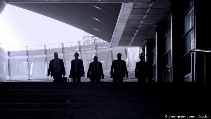 several figures walking toward camera, darkQuelle: http://www.thebrusselsbusiness.eu/eu/press/