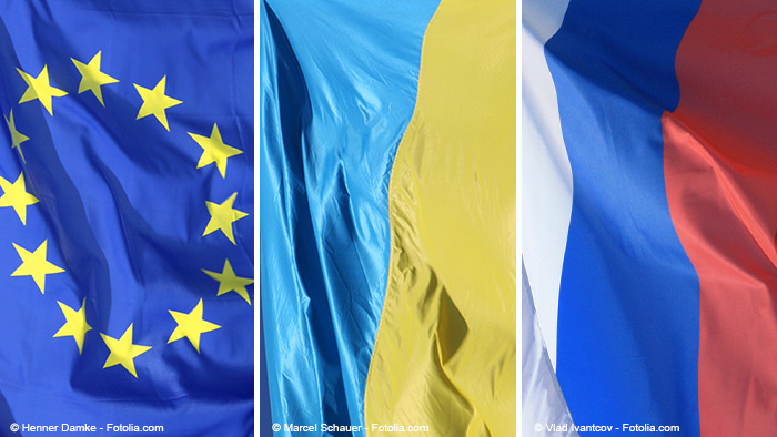 Photomontage with a flag each from EU, Ukraine and Russia