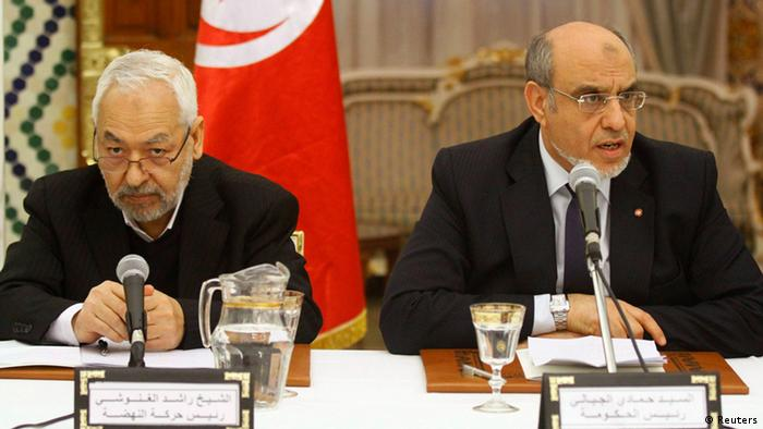 Rached Ghannouchi, head of the Ennahda movement (L) and Prime Minister Hamadi Jebali listen during a round of consultations with other political parties at the Carthage Palace in Tunis, February 15, 2013. REUTERS/Anis Mili (TUNISIA - Tags: POLITICS)