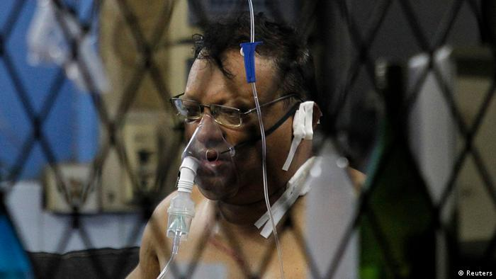 Journalist Faraz Shauketaly, who writes for the Sri Lankan newspaper The Sunday Leader, receives treatment for his injuries (REUTERS)