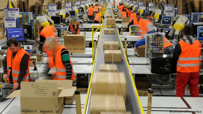 Workers sort packages at Amazon warehouse in Germany. (Photo: Jan-Philipp Strobel/dpa)