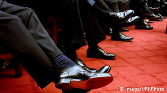 Men's legs with dress pants and black shoes