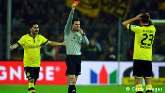 DORTMUND, GERMANY - FEBRUARY 16: Referee Felix Brych shows Julian Schieber of Dortmund the red card during the Bundesliga match between Borussia Dortmund and Eintracht Frankfurt at Signal Iduna Park on February 16, 2013 in Dortmund, Germany. (Photo by Lars Baron/Bongarts/Getty Images)