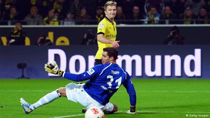 Marco Reus of Dortmund scores his teams second goal against goalkeeper Kevin Trapp of Frankfurt during the Bundesliga match between Borussia Dortmund and Eintracht Frankfurt February 16, 2013 in Dortmund, Germany. (Photo by Lars Baron/Bongarts/Getty Images)