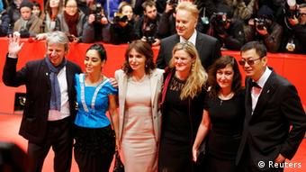 Jury members Andreas Dresen, Shirin Neshat, Susanne Bier, Tim Robbins, Ellen Kuras, Athina Rachel Tsangari and president Wong Kar Wai (L-R) arrive for the screening of the movie Side Effects at the 63rd Berlinale International Film Festival in Berlin February 12, 2013. REUTERS/Thomas Peter (GERMANY - Tags: ENTERTAINMENT)