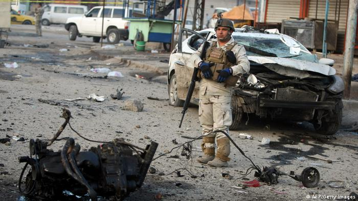 An Iraqi soldier stands guard at the site of a blast after a bomb ripped through a group of workers in Sadr City in Baghdad on January 24, 2012. A series of car bombs exploded in Shiite areas of Baghdad, killing at least nine people and injuring more than 60, an interior ministry official said. AFP/PHOTO/AHMAD AL-RUBAYE (Photo credit should read AHMAD AL-RUBAYE/AFP/Getty Images)