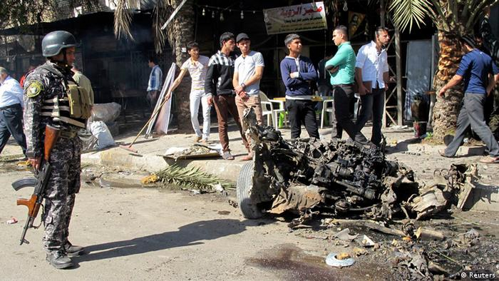 A policeman stands guard at the site of car bomb attack in the KarraKda district in Baghdad (Photo - REUTERS)
