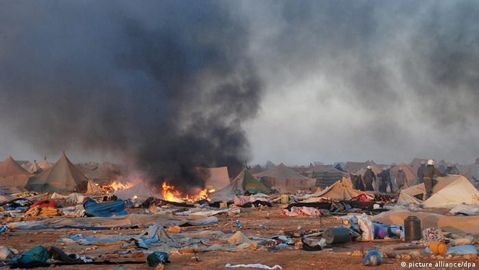 A handout photograph made available by the Maghreb Arab Press Agency (MAP) on 08 November 2010 shows Moroccan security forces dismantling a tent camp on the outskirts of Laayoun, western Sahara's capital, on 08 November 2010. According to media reports, clashes have erupted between Moroccan security forces and protesters in Western Sahara on 08 November in which several people were killed, after Moroccan security forces dismantled tents of the 'Gdaim Izik' camp that was the site of an anti government protest. EPA/HANDOUT EDITORIAL USE ONLY