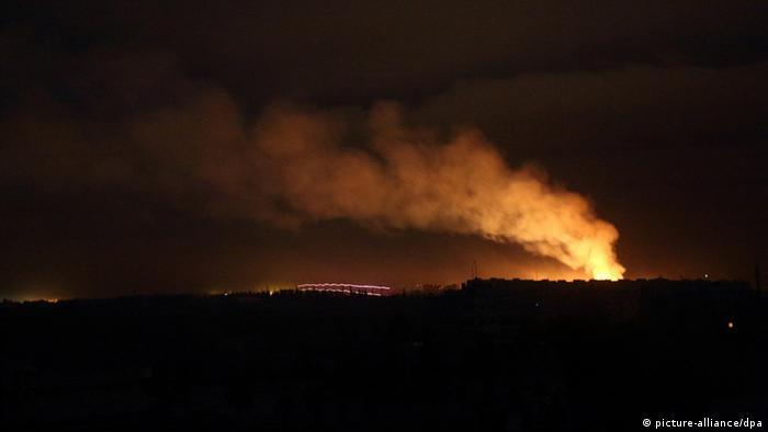 The sky over Aleppo (Syria) is illuminated by fires that broke out during an attack of the Free Syrian Army (FSA) on the Nayrab military airport and the Aleppo International Airport on February, 16. 2013. Photo: Jan A. Nicolas