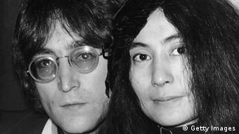 Japanese-born artist Yoko Ono and her husband, singer and songwriter John Lennon (1940 - 1980) at Selfridges department store in London to autograph copies of Ono's new book 'Grapefruit', 15th July 1971. (Photo by Central Press/Hulton Archive/Getty Images)