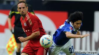 Bayern Munich's French midfielder Franck Ribery (L) and Schalke's Japanese defender Atsuto Uchida vie for the ball during the German first division Bundesliga football match FC Schalke 04 vs. FC Bayern Munich in Gelsenkirchen, western Germany, on September 18, 2011. Photo credit should read PATRIK STOLLARZ/AFP/Getty Images