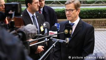 epa03589238 German Foreign Minister Guido Westerwelle speaks to the media as he arrives for a Foreign Affairs council meeting at the EU Council headquarters in Brussels, Belgium, 18 February 2013. The Council, chaired by EU High Representative Catherine Ashton discuss the situation in the EU's southern neighbourhood and will also take stock of EU actions to support Mali. European Union foreign ministers were set for a showdown over the bloc's arms embargo on Syria, while tighter sanctions on North Korea were expected to get waved through. EPA/JULIEN WARNAND
