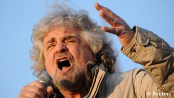 Five-Star Movement leader and comedian Beppe Grillo gestures during a rally in Turin February 16, 2013. REUTERS/Giorgio Perottino (ITALY - Tags: POLITICS ELECTIONS)