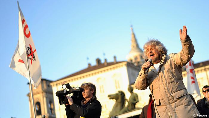Beppe Grillo gestures during a rally in Turin, February 2013