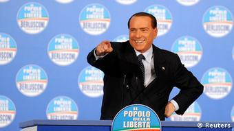 Former Italian Prime Minister Silvio Berlusconi gestures during a political rally in Turin February 17, 2013. REUTERS/Giorgio Perottino (ITALY - Tags: POLITICS TPX IMAGES OF THE DAY)