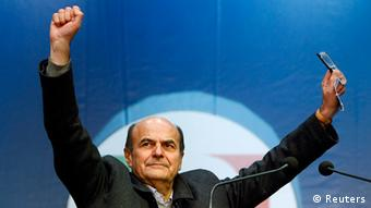 Italy's Democratic Party (PD) leader Pier Luigi Bersani gestures as he arrives for a political rally in downtown Milan February 17, 2013. Voters will go to the polls in a parliamentary election on February 24 and 25. REUTERS/Alessandro Garofalo (ITALY - Tags: POLITICS ELECTIONS))