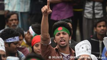A Bangladeshi youth shouts slogans as Bangladeshi social activists and bloggers participate in a demonstration demanding the death sentence for the country's war criminals during a nationwide strike in Dhaka on February 18, 2013. (Photo:MUNIR UZ ZAMAN/AFP/Getty Images)