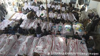 Pakistani Shiite Muslims gather around the coffins of bomb attack victims as they demonstrate in Quetta on February 18, 2013. Thousands of women refused Monday to bury victims of a bloody bombing and a strike shut down Pakistan's biggest city Karachi as protesters across the country demanded protection for Shiite Muslims. AFP HOTO/Banaras KHAN (Photo credit should read BANARAS KHAN/AFP/Getty Images)