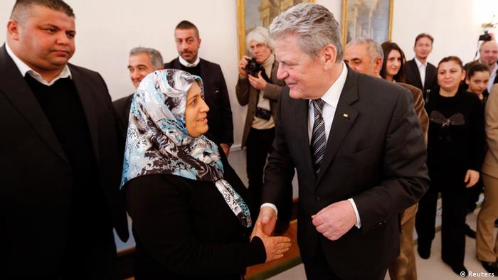 Gauck welcomes Ayse Yozgat during a meeting of relatives of the victims REUTERS/Fabrizio Bensch