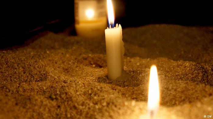 Kerzen in der St Johann Baptist Kirche in Köln (Foto: Naomi Conrad/DW)