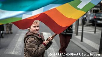 A child with a rainbow flag (photo: JEFF PACHOUD/AFP/Getty Images)