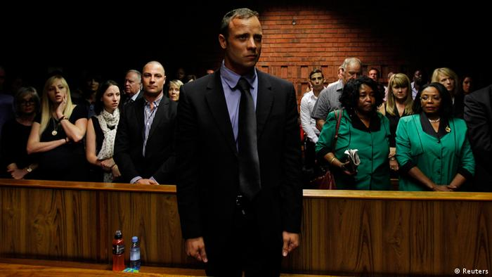 Blade Runner Oscar Pistorius awaits the start of court proceedings in the Pretoria Magistrates court February 19, 2013. Photo - REUTERS